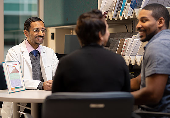 Reproductive endocrinologist Musa Zamah consulting with a couple