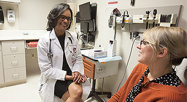 Dr. Monica Christmas consults with a gynecology patient