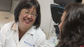 Nicole Leong, MD, gynecologist, with patient