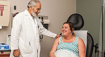 Maternal-fetal medicine expert Mahmoud Ismail, MD, consults with a patient