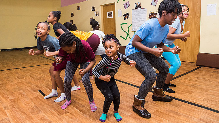 Members of Global Girls, Inc. practice dance moves for a performance