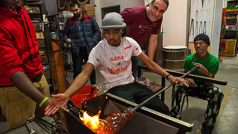 Bradley Stolbach, PhD, mentors students in Project Fire, a glassblowing program for youth affected by violence