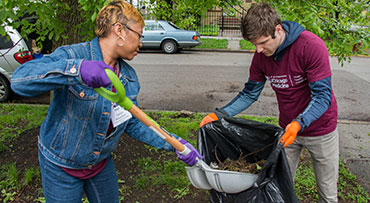 Two UChicago Medicine Day of Service and Reflection (DOSAR) volunteers performing gardening tasks