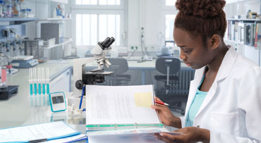 African-American female researcher in lab