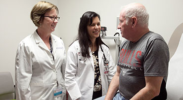 Two endocrinologists speaking with a patient