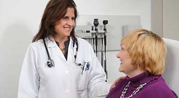 Endocrincologist, Silvia Pannain, speaks with a patient during an appointment