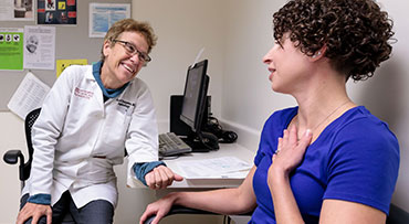 Dr. Arlene Chapman, a nephrologist, meets with a patient