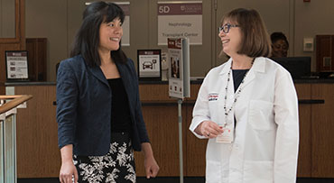 Dr. Michelle Josephson, a nephrologist, speaks with a patient