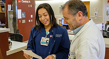 Neurointensivist Fernando Goldenberg, MD, and nurse working together in the Neurointensive Care Unit