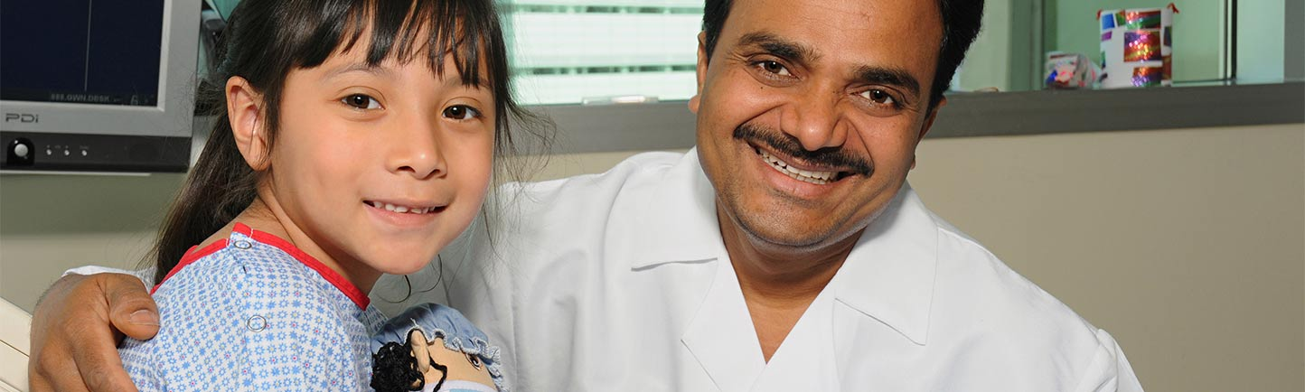 Pediatric urologist Mohan Gundeti, MD, with a patient