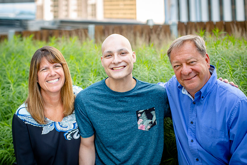 Pediatric cancer survivor with his family